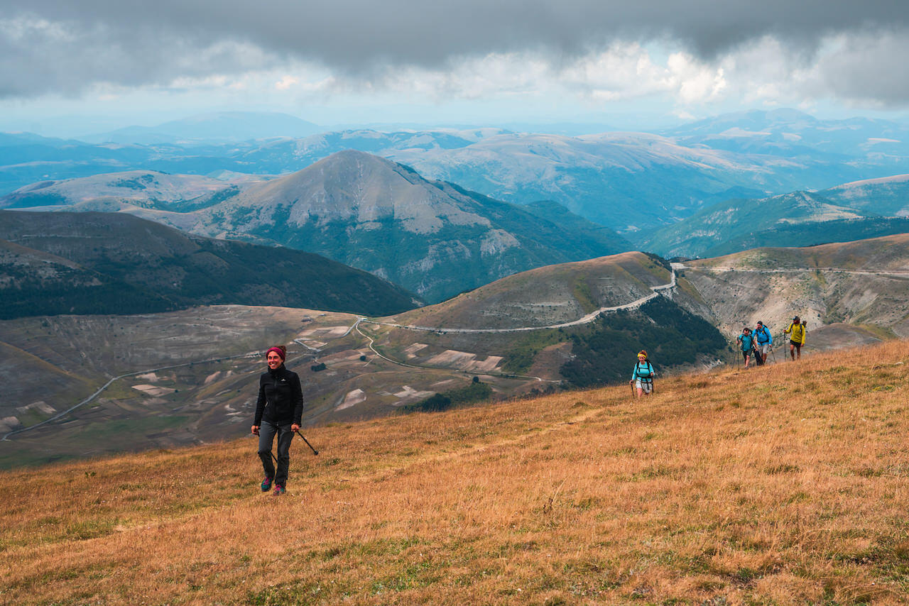 Reaching the peak of Mount Vettore in the Sibillini Park_marche region_with guest people walking with VS team